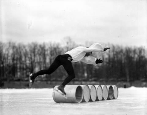 Red McCarthy, a Canadian Olympic skater, jumpsbarrelsin1935.