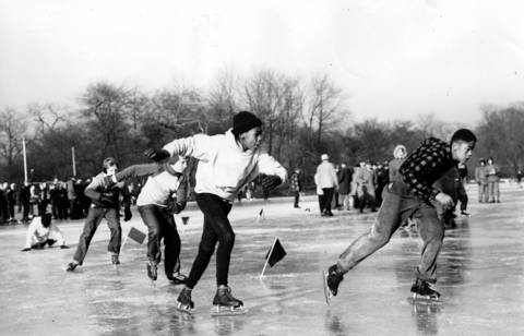 Larry Jensen, right, races to victory in the juvenile boys quarterfinal event during the Silver Skates Derbies on Jan. 23, 1954. Also competing are Henry Archambault, second from right, Alan Nemeth, and Ron Horton.