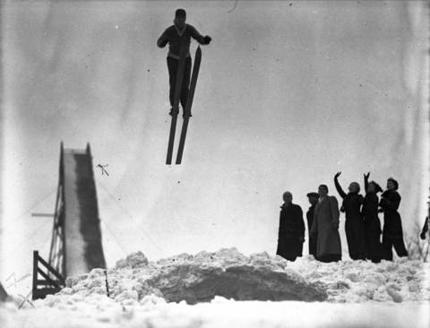 Howard Jansen, of the Norge Ski Club, jumps during the clubs 30th annual ski jump tournament on Jan. 19, 1936. Due to fresh snow falling the day before, ten Norge ski jump records were broken on this day, due to fast conditions. The Chicago Tribune reported 15,000 spectators watched the popular winter tournament.