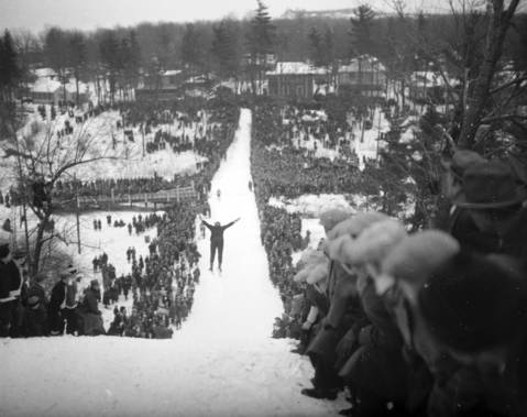 Approximately 8,000 spectators watched as jumpers descended the slide during the Grand Beach Ski Club ski jump tournament held in Grand Beach, Michigan on Jan. 23, 1927. Casper Olmen, of Grand Beach, won the title on a 118 foot jump. Olmen would go on to become an Olympic ski jumper.