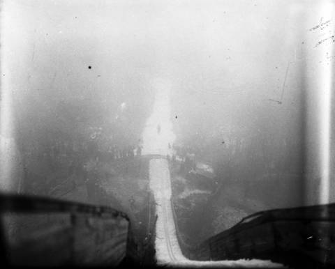 """With snow imported from Escanaba, Mich., the Norge Ski Club held their 23rd annual ski jump tournament on Jan. 20, 1935 in Fox River Grove, Ill. The headline from the Chicago Tribune read """"15,000 watch jumpers soar through fog."""" The fog was so thick, the spectators could only see the jumpers at the bottom of the ski slide. The damp, warm weather also slowed the slide and none of the jumpers came close to the record jump at the time, which was 183 feet."""