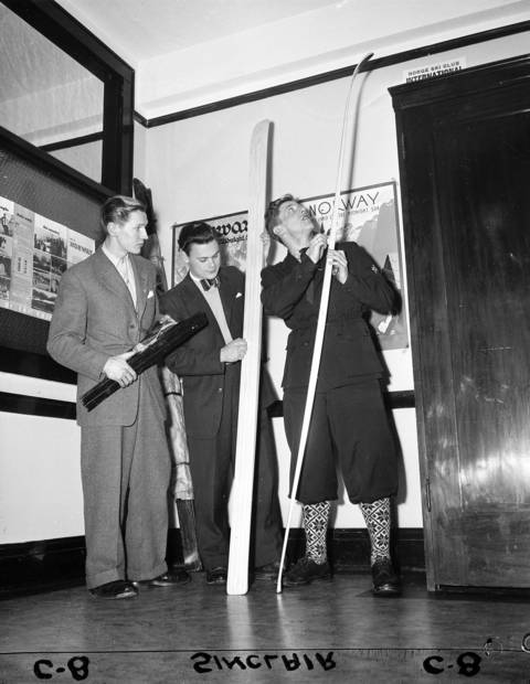 Skiers Wilhelm Hellman, 26, of Stockholm, Sweden, left, Bengt Jaderholm, 21, of Stockholm, Sweden, middle, and Petter Hugsted, 27, of Kongsberg, Norway (the 1948 Norway Olympic Champion) clean up their gear at 11 S. LaSalle Street in Chicago on Jan. 4, 1949. The skiers were here for the annual Norge Ski Club tournament held on Jan. 16, 1949. Hugsted won the ski jump with a distance of 192 feet to win the class A title at the 43rd annual Norge Ski Club meet at Fox River Grove. Imported snow on the slide was the only touch of winter for the countryside during the event witnessed by 15,000. Jaderholm won third place with a 185 and 192 feet jump.
