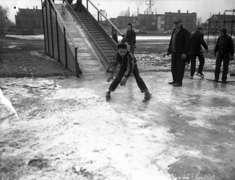 Robert Foster, 12, skis down a toboggan slide on home made skis at Gary Park, 3000 S. Lawndale Avenue in January 1950.