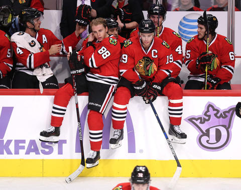 Patrick Kane and Jonathan Toews wait to start overtime against the St. Louis Blues at the United Center.