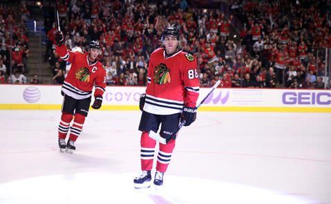 Patrick Kane and Jonathan Toews celebrate after a goal by Kane in the first period of a game against the St. Louis Blues.