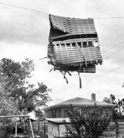 May 1965: An awning from an Addison restaurant hands from a utility wire after it was thrown by a tornado.