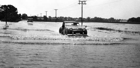 June 1967: A small sports car and a truck move through floodwaters on Villa Avenue near Armitage Avenue in Addison.