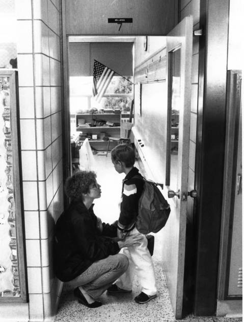 September 1987: Bobbi Benning reassures her son Chad, 7, before he enters class at Army Trail Elementary School on opening day in Addison.
