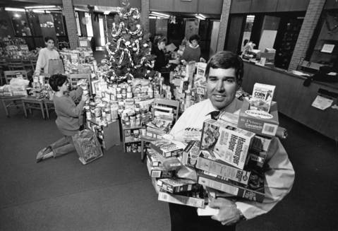 December 1986: Steve Pietz, a teacher at Indian Trail Junior High School in Addison, holds some of the 2,600 items collected from 749 students during a four-day student council food drive.