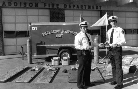 December 1988: Addison Fire Chief Ralph Blust and Paramedic Coordinator Lt. Dave Adler with a range of emergency response gear.