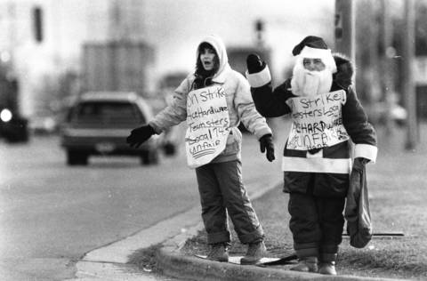 December 1989: Barbara Bosak dons a Santa suit as she joins fellow Teamster Debbie Keating on the picket line outside the Ace Hardware warehouse on Route 53 and Fullerton Avenue in Addison.