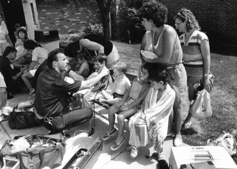 July 1990: Parents console children as paramedics administer oxygen after a chlorine gas leak at Community Park pool, 112 E. Oak St. in Addison. Fifteen swimmers with breathing problems were taken to area hospitals; seven were admitted for observation.