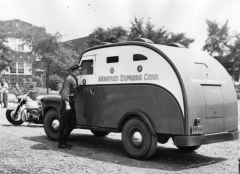 July 1952: A look at an armored currency truck which was held up at Ogden and Clinton Avenues.