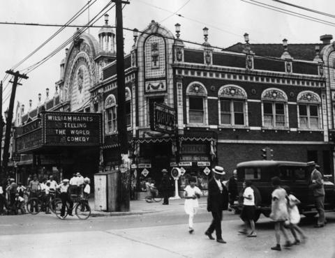 """A look at the hustle and bustle outside the Parthenon Theater at Cermak Road and Ridgeland Boulevard in Berwyn, where a small bomb exploded and 12 sticks of undetonated dynamite were found the day before on Aug. 29, 1928. If the entire batch of dynamite had exploded, """"It would have sent the whole structure crashing to the ground"""", the Tribune reported. The theater was later demolished in the 1990s after it lay vacant for years."""