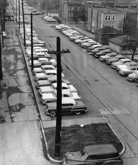 March 1958: What was once the right of way of the Douglas Park 'L' line is now free parking along Lombard Avenue.