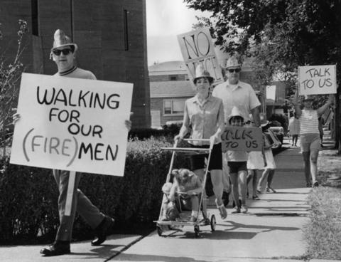 August 1969: Berwyn firefighters and their families picket city hall for a $2,000 pay raise.