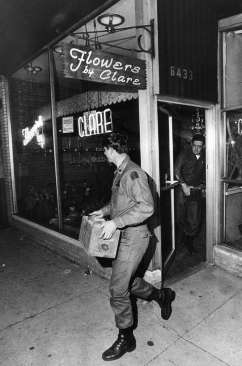 October 1971: Men from Fort Sheridan remove boxes of weapons from a Flowers by Clare flower shop after treasury agents discovered what was described as one of the largest arms caches ever found in the Chicago area.