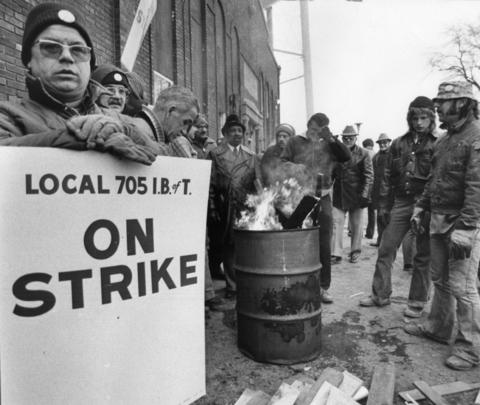January 1976: Striking Berwyn garbage collectors try to keep warm outside the city garage as all other city services except police and fire protection were shut down in a labor dispute.