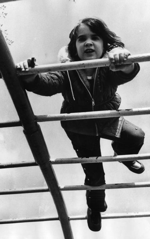 March 1976: Spending a playful morning at Maple Avenue Park, Sandra Miller, 4, ventures onto the parallel bars.