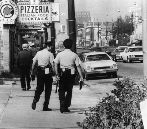 September 1976: Officers Fred Cozzi and Bernard Dombowski walk their beat along Cermak Road, as many Berwyn cops do. They claim that their cars are too unsafe.