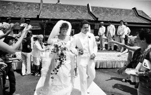 June 1983: Well-wishers toss rice at newlyweds Kathy Ladd, 23, and Jerry Zdenek, 22, after the couple's wedding outside a McDonald's restaurant in Berwyn. The couple were treated to the golden arches gala after winning a drawing organized by the Cermak Road Business Association. About 1,800 people witnessed the event, which was held atop a flatbed truck in the restaurant's parking lot.