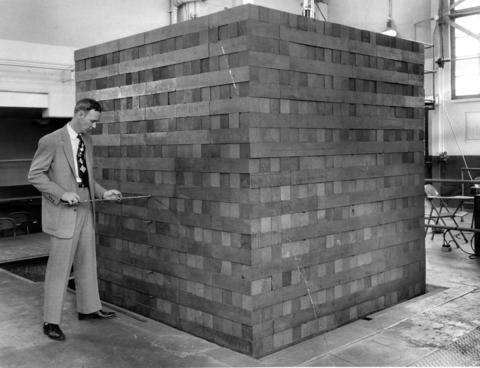 April 1956: A subcritical reactor constructed at Argonne National Laboratory. This eight-foot cube contains 30 tons of graphite interwoven with 2 1/2 tons of uranium.