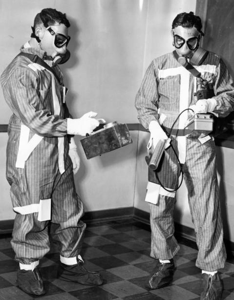 "June 1958: William B. Grant, left, with a Samson survey meter and Walter H. Smith, with a gamma survey meter, are members of the ""Radiological Safety Team"" at Argonne National Laboratory. In the event of radiation accidents, the team operates within a 10-state radius to control the damage."