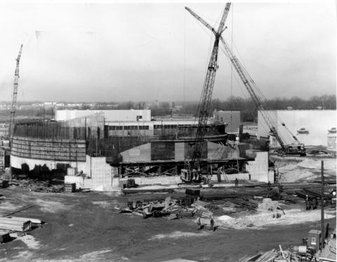 "February 1961: Construction progresses in Lemont on Argonne National Laboratory's new circular atom smasher, the Zero Gradient Synchrotron. The ""atomic race track"" will be housed in a cement doughnut 210-feet in diameter and 58-feet high and will be buried as a shield against radiation."