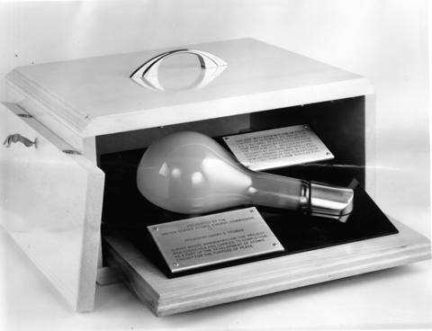 "April 1964: On Dec. 20, 1951, this 200-watt lightbulb, and three others like it, were lighted by electrical energy produced through the use of Experimental Breeder Reactor I (EBR-I). This feat marked the first known production of usable amounts of electricity created by nuclear means. The bulb was presented to Harry S. Truman, then President of the United States. The Atomic Energy Commission, which financed the reactor, and Argonne National Laboratory, designer and operator, have announced decommissioning of the historic ""atomic furnace."""
