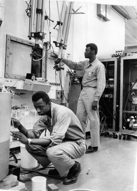 March 1970: Technicians Michael Gordon, left, 20, and Vertice Piphus, 18, work in the Argonne National Laboratory as part of the facility's Black Employment Program.