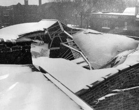 Heavy snow accumulation collapsed the roof of a warehouse at 3420 Irving Park Road on Jan. 26, 1967.