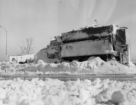 A snow plow abandoned on North Lake Shore Drive in Chicago on Jan. 28, 1967, is just one of many lost during the blizzard that lasted two days.