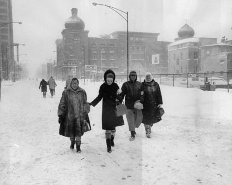 Pedestrians fear no automobile traffic on Ohio Street near Rush Street in Chicago on Jan. 27, 1967, after a record-setting snowfall hit the city.