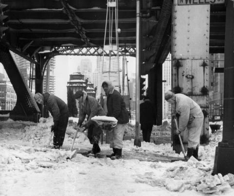City workers clear a sidewalk at Wells Street and Wacker Drive on Jan. 28, 1967, after two days of nonstop snow.