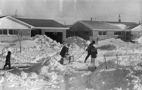 A Midlothian family brings groceries home using a sled on Jan. 29, 1967, after the area's worst snowstorm.