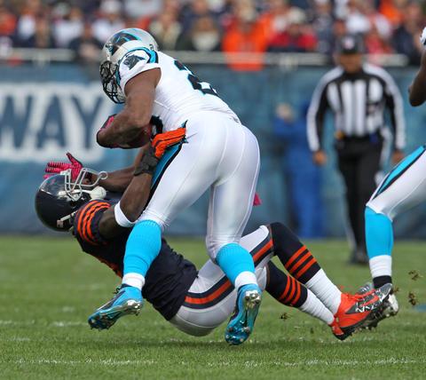 Cornerback Charles Tillman tackles Panthers running back Jonathan Stewart during the first quarter.