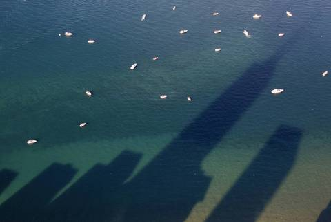 Building shadows fall on Lake Michigan on July 3, 2014.