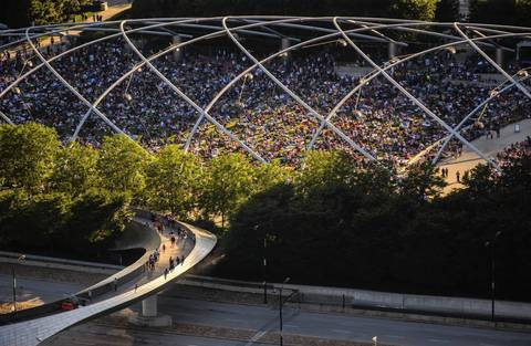 Fourth of July concertgoers head into Jay Pritzker Pavilion in Millennium Park in 2014.