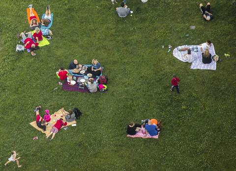 Families relax near the Lakefront Trail at Randolph Street in Chicago on Independence Day in 2014.