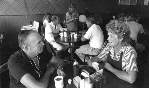 Koffee Kup owner Joan Chucik (front right) talks with customer Blair Slocum while waitress Lyn Foelker takes orders from Bob Hale (rear left) and Larry Pugsley.