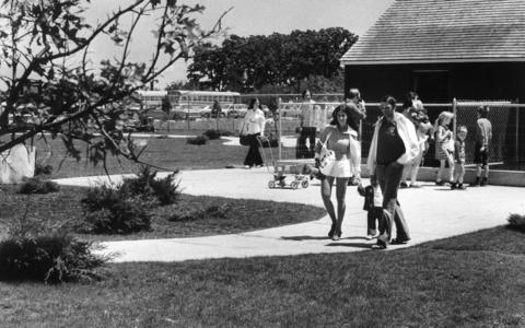 June 18, 1974: Patrons stroll through the petting zoo at Lambs Farm.