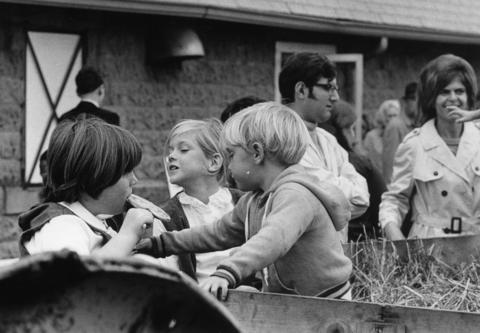 Oct. 26, 1971: Families enjoy the clam bake and shopping while children go for a hay ride.