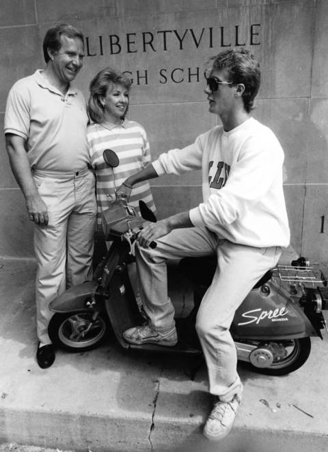 June, 1987: Libertyville senior Patrick Lenihan tries out a scooter that was given out as a prize at a graduation party. Pictured with Lenihan are party chairpersons Nancy and Don Robinson.