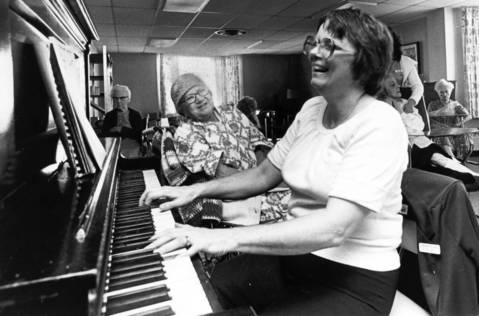 Oct., 1983: Music therapist Lorraine Pellant plays for seniors at the Winchester House.