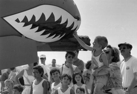 Aug., 1991: Siobhan White of Arlington Heights holds her five-year-old son, Aidan, as he feels the nose of an A-10 Warthog at the air station's Air Expo.