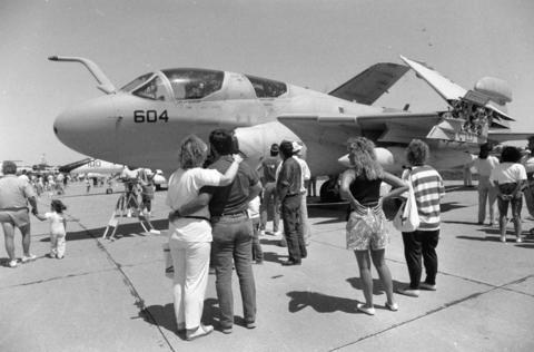 May, 1991: Attendees at the NAS Glenview Air Expo look over an EA-6B Prowler Navy plane.