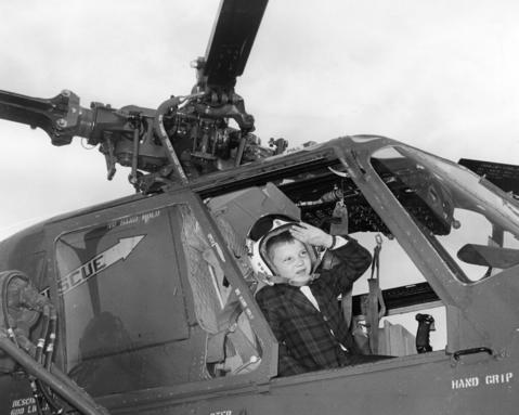 Nov., 1964: Jim Matthews, 8, of Winnetka, sits in the cockpit of a helicopter during an open house.