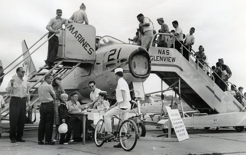 Aug. 1962: A large crowd views an FJ-4 Fury at an open house for the 25th anniversary of the base.