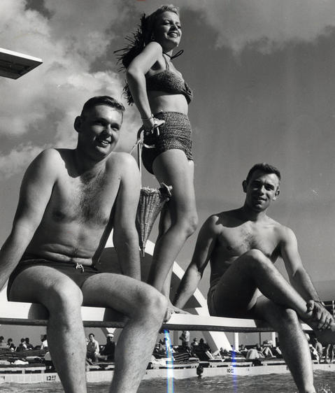 Jan., 1956: Glenview airmen and a hotel guest visit a Miami Beach swimming pool. In the evenings, flyers in training had time for relaxation and recreation.