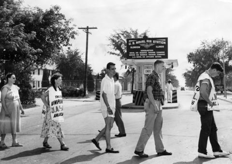 July, 1955: Striking employees of Electronic Circuits plant in Glenview picket the main gate of Glenview Naval Air Station because some sailors stationed at the base had been working at the plant in their off hours. Pickets halted some truck deliveries.